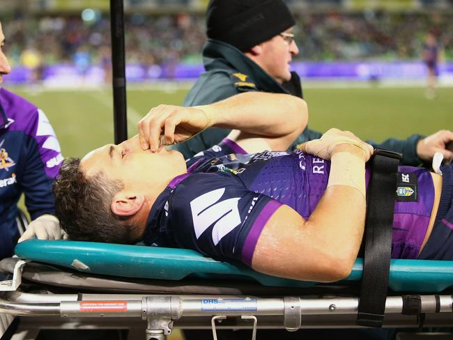 CANBERRA, AUSTRALIA - JULY 22:  Billy Slater of the Storm is taken from the field after a tackle by Iosia Soliola of the Raiders during the round 20 NRL match between the Canberra Raiders and the Melbourne Storm at GIO Stadium on July 22, 2017 in Canberra, Australia.  (Photo by Mark Nolan/Getty Images)