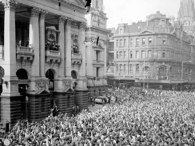 Thousands of fans packed the streets to see the band at the Melbourne Town Hall when the Beatles arrived for their state reception. Picture: Herald Sun Image Library