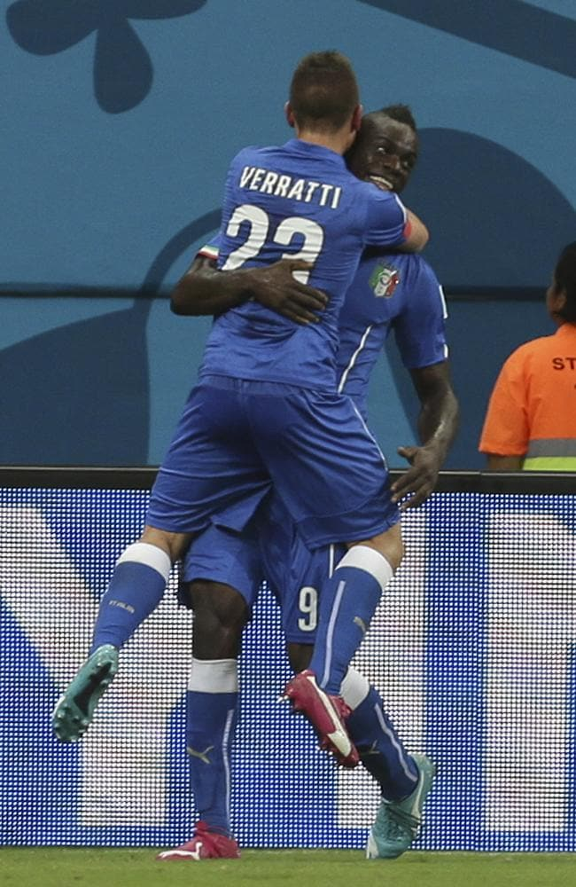 Italy's Mario Balotelli celebrates with Marco Verratti after scoring his side's second goal during the Group D World Cup match against England.