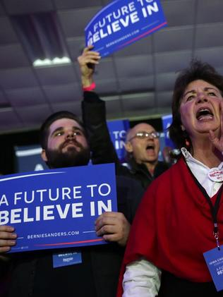 Supporters cheer during Democratic presidential candidate Bernie Sanders' caucus night party. Picture: Getty
