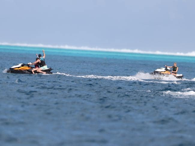 Karl rides ahead of Jasmine in the beautiful waters of Bora Bora. Picture: BackGrid