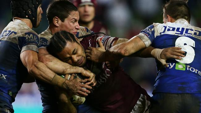 Manly's Steve Matai takes a hit-up.