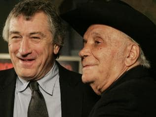 """FILE - In this Jan. 27, 2005, file photo, Robert DeNiro, left, and boxer Jake LaMotta stand for photographers before watching a 25th anniversary screening of the movie """"Raging Bull"""" in New York. LaMotta, whose life was depicted in the film """"Raging Bull,"""" died Tuesday, Sept. 19, 2017, at a Miami-area hospital from complications of pneumonia. He was 95. (AP Photo/Julie Jacobson, File)"""