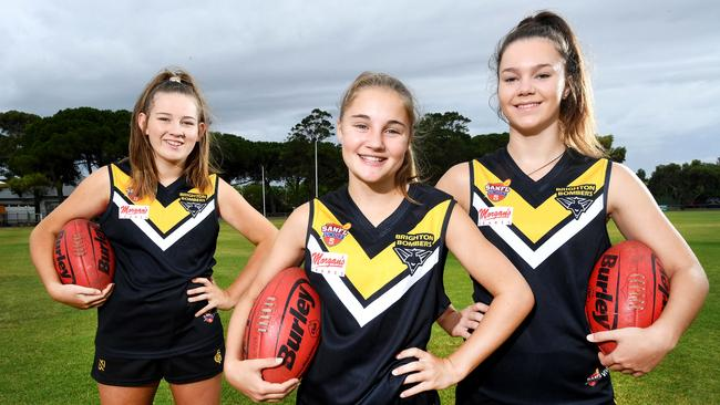 Brighton Bombers female footballers Sarah Rea, Emma Moase and Bella Bailey. Picture: AAP/Mark Brake