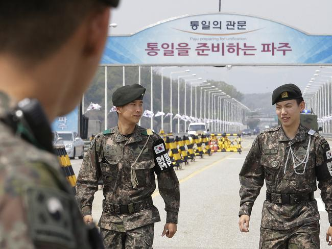 South Korean army soldiers patrol at Unification Bridge, which leads to Panmunjom in Paju, South Korea. Picture: AP