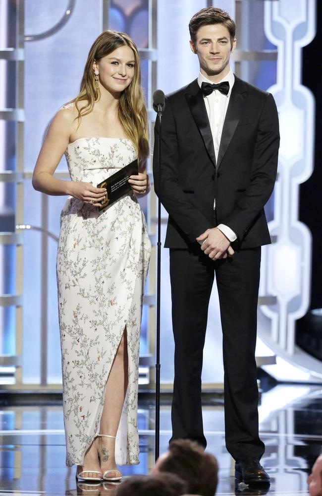 Melissa Benoist and Grant Gustin speak onstage during the 73rd Annual Golden Globe Awards at The Beverly Hilton Hotel on January 10, 2016 in Beverly Hills, California. (Photo by Paul Drinkwater/NBCUniversal via Getty Images)