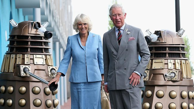 Prince Charles and Camilla, Duchess of Cornwall pose next to two Daleks as they visit BBC Roath Lock Studios in Cardiff.