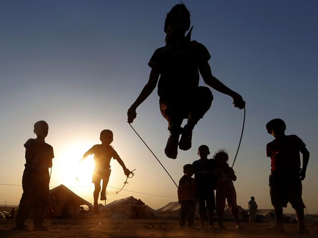 Iraqi displaced children play at a temporary camp on June 27, 2014 in Aski kalak, 40 kms west of the Kurdish autonomous region's capital Arbil. Photo: KARIM SAHIB