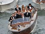 Actor George Clooney, right, waves from a boat with Ramzi Alamuddin, third from right front row, father of her fiancee Amal Alamuddin, his father Nick Clooney, fourth from right front row, and his mother Nina Bruce, second from right back row on their way to the Aman hotel ahead of his wedding in Venice, Italy on Saturday, September 27th 2014. Picture: AP