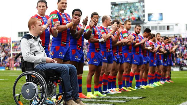 Alex McKinnon alongside his team-mates at the Rise For Alex weekend. Pic Brett Costello