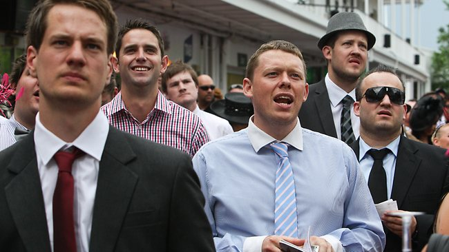 These punters don't look too happy with the result of the race. Hopefully they didn't blow all their money on it.