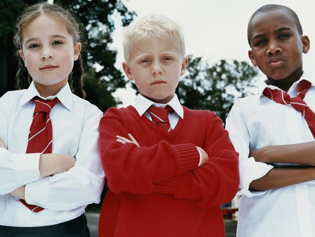 These kids skipped school so they could stand around looking tough all day.