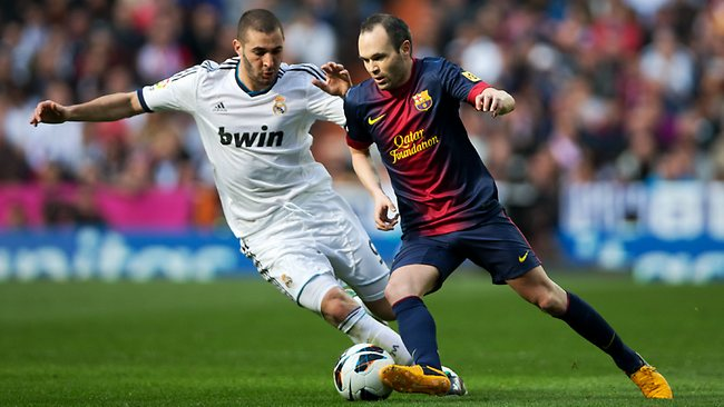 Andres Iniesta (R) of Barcelona duels for the ball with Karim Benzema of Real Madrid in Madrid. Picture: Jasper Juinen