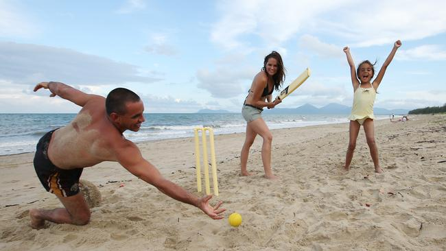 7. Australia Day classic: Beach cricket at Yorkey's Knob — one of Cairns' northern beaches. Picture: Brendan Radke.