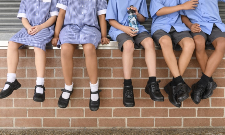Mobile phones will be banned in all NSW schools from next year