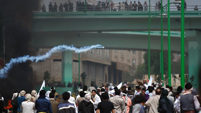 A protester, unseen, throws a tear gas canister, which was earlier thrown by riot police, during clashes near the U.S. Embassy in Sanaa, Yemen, Friday, Sept. 14, 2012, as part of widespread anger across the Muslim world about a film ridiculing Islam's Prophet Muhammad. (AP Photo/Hani Mohammed)