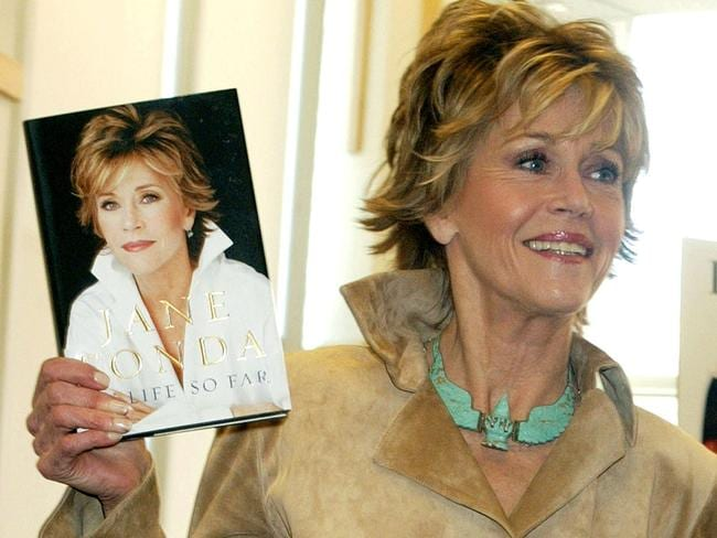 Jane Fonda with a copy of her autobiography, My Life So Far, in 2005.