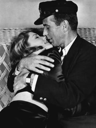 Beautiful ... Humphrey Bogart holds Lauren Bacall in a scene from To Have and Have Not.