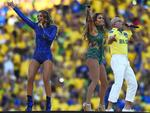 (L-R) Singers Claudia Leitte, Jennifer Lopez and Pitbull perform during the Opening Ceremony of the 2014 FIFA World Cup Brazil prior to the Group A match between Brazil and Croatia at Arena de Sao Paulo on June 12, 2014 in Sao Paulo, Brazil. (Photo by Buda Mendes/Getty Images)