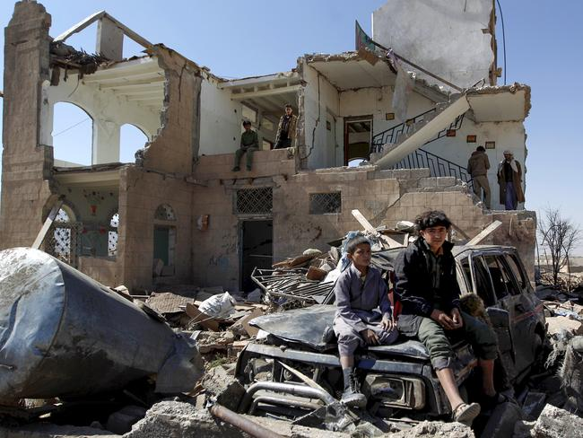 Children sit in the rubble of a house hit by Saudi-led coalition air strikes on the outskirts of the Yemeni capital Sanaa. Picture: Mohammed Huwais/AFP