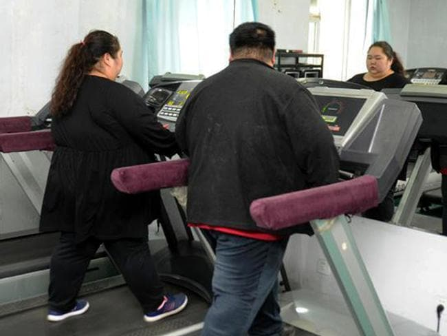 Lin Yue and Deng Yang hit the treadmills. Picture: CEN/australscope