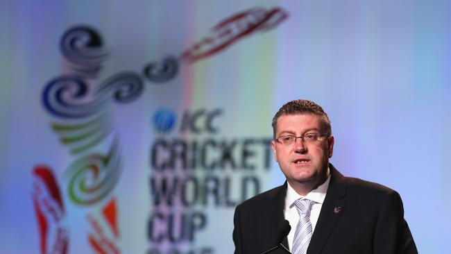 This swirly logo probably cost the same as 15 cricket academies. Pic of John Harnden, CEO, ICC Cricket World Cup 2015, by Scott Barbour/Getty Images.