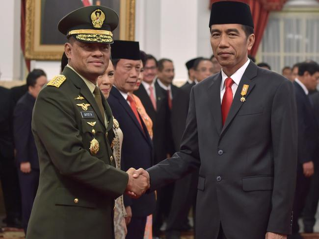 Indonesia's President Joko Widodo (right) shakes hands with Gatot Nurmantyo after he is sworn in as the country's military chief in 2015. Picture: AFP/Adek Berry