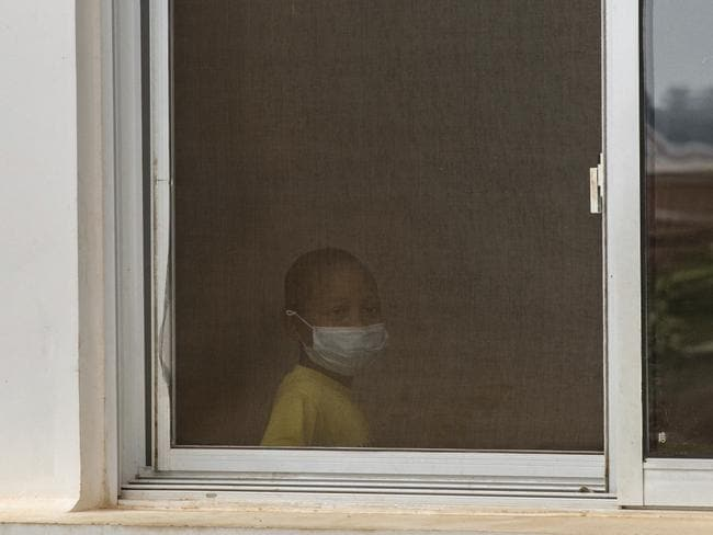 A child wears a face mask inside a hospital in Antananarivo, Madagascar. Picture: AP/Alexander Joe
