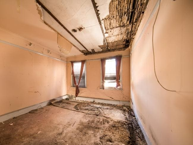 'Bring your architect, bring your builder' says the seller of this abandoned four bedroom house in Sydney's Surry Hills. Picture: realestate.com.au.
