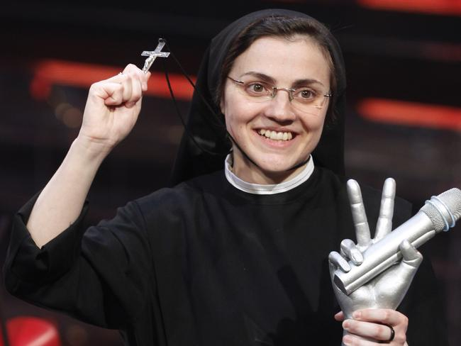 Sister superior ... The singing nun poses with the trophy and a crucifix after winning the show's finale. Picture: Luca Bruno