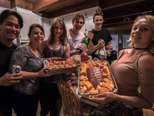 """Cooking up a """"family dinner"""" in our Airbnb in Oakhurst, California, near Yosemite National Park. Picture: Brian Nakayama"""