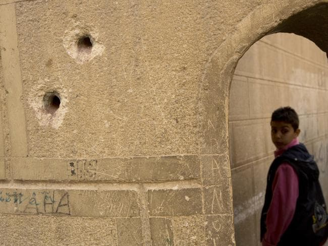 Bullets holes are seen on the police booth outside Mar Mina church. Picture: AP Photo/Amr Nabil