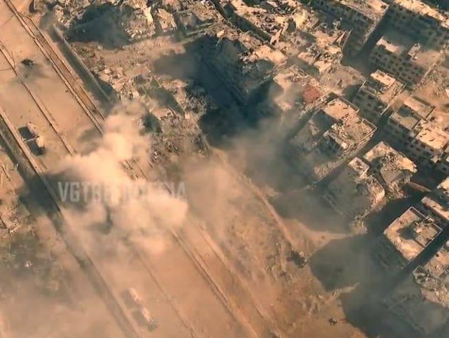 Highway to hell ... Fighting rages amid the ruins of Jobar.