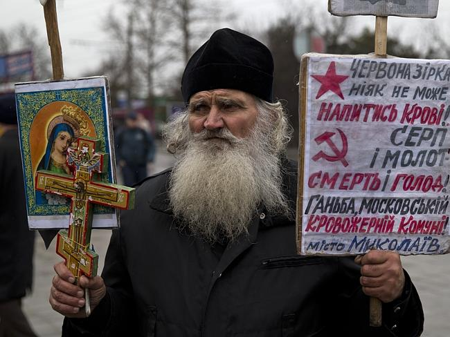 Still hopeful...A Ukrainian orthodox monk attends a rally against the breakup of the country in Simferopol, Ukraine. Picture: AP