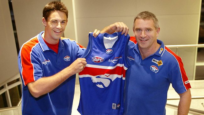Jade Rawlings holds his Western Bulldogs guernsey with Peter Rohde