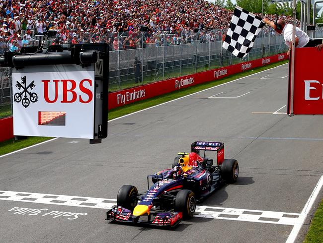 Ricciardo crosses the line to take his first F1 win.