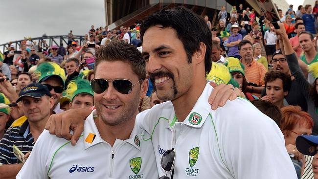 Mitchell Johnson celebrates the Ashes series triumph with captain Michael Clarke at the Sydney Opera House.