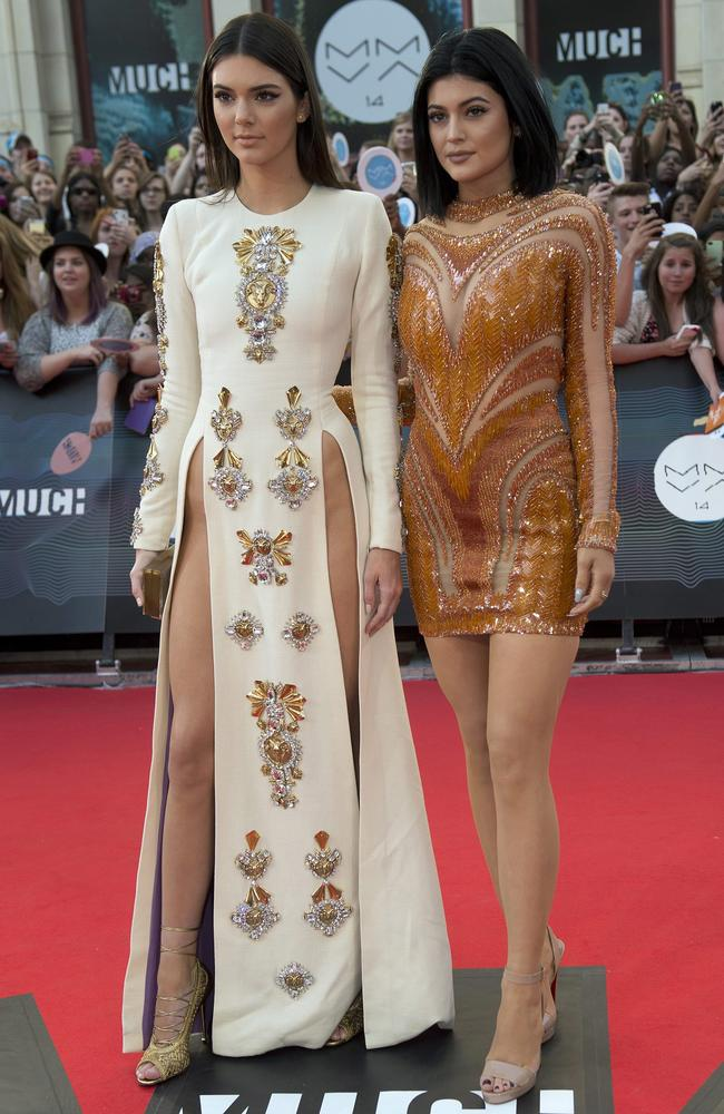 Kendall and Kylie Jenner arrive on the red carpet at the 2014 Much Music Video Awards in Toronto.