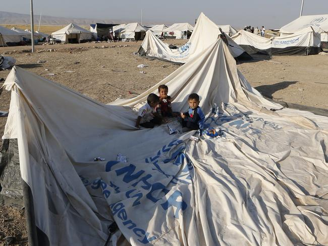 Children sit on disassembled tent at a camp for displaced Iraqi Shiite Turkmen who fled their town of Tal Afar, in Shikhan, in Kurdistan's Dohuk province, last week. Photo: KARIM SAHIB