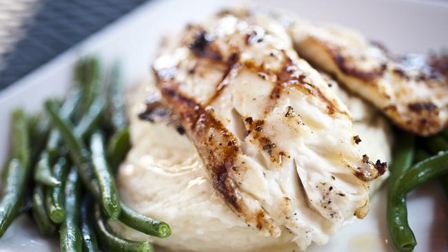 Chargrilled white fish with green veggies.