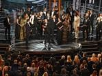 "The cast of ""Moonlight"" and """"La La Land"" appear on stage as presenter Warren Beatty (, flanked by host Jimmy Kimmel shows the winner's envelope for Best Movie ""Moonlight"" on stageduring the 89th Annual Academy Awards. Picture: AFP"