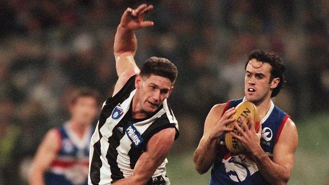 Bulldog Simon Garlick (right) marks against Collingwood's Gavin Crosisca. Picture: Michael Dodge