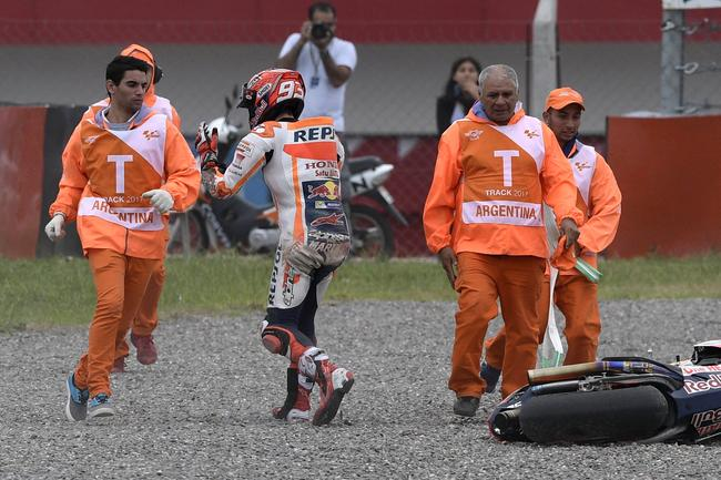 Marquez storms away from his crashed bike.