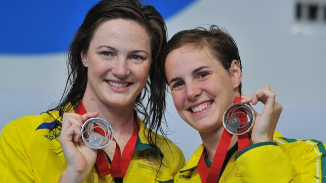 Aussie medallist sisters Cate and Bronte Campbell pose on the podium after the Women's 50m Freestyle.