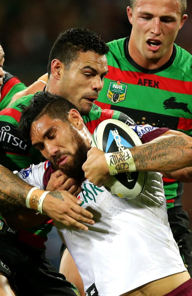 Manly's Jesse Sene-Lefao tackled by South Sydney's Ben Te'o and Issac Luke.
