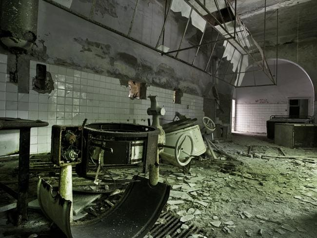 Stuck in time ... the kitchen still covered in asbestos on the haunted Poveglia Island. Picture: Ella Pellegrini