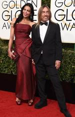 Nina Alu and Iggy Pop attend the 74th Annual Golden Globe Awards at The Beverly Hilton Hotel on January 8, 2017 in Beverly Hills, California. Picture: AFP