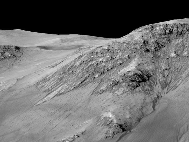 Chance find ... A PhD student first discovered irregular streaks appearing and disappearing on the surface of Mars in 2011. Picture: AFP/NASA