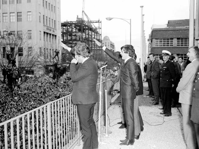 Saluting fans ... The Beatles imitate a Nazi salute on the balcony of the Southern Cross Hotel in Melbourne.