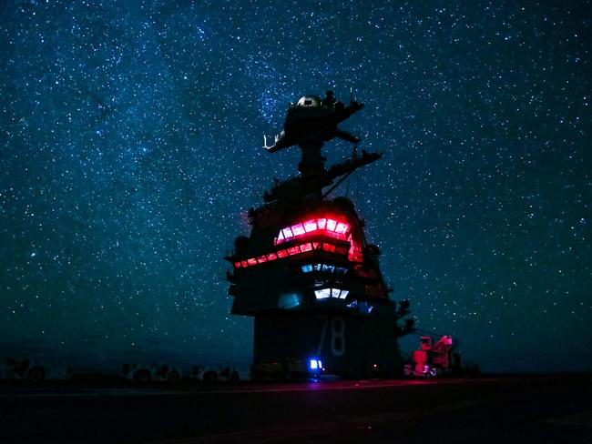 Aircraft carrier USS Gerald R. Ford as it transits the Atlantic Ocean at night. The US Navy is teaching sailors how to navigate by the stars with the help of sextants, first used in the 18th century. Picture: Joshua Sheppard